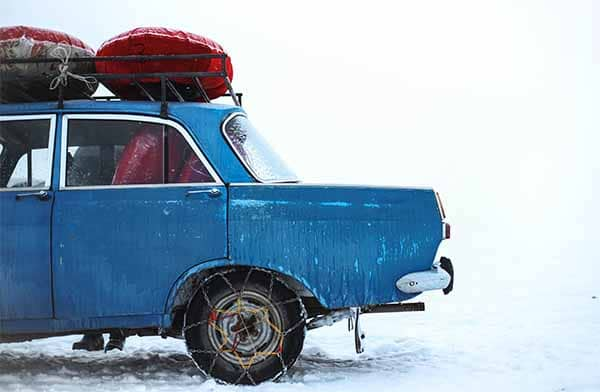 winter emergency car kit blue car in snow