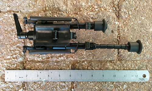 Harris clone rifle bipod swivel mount with leg extended.